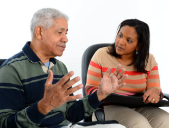 senior man with female counselor