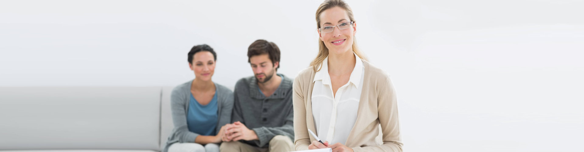 couple with therapist smiling